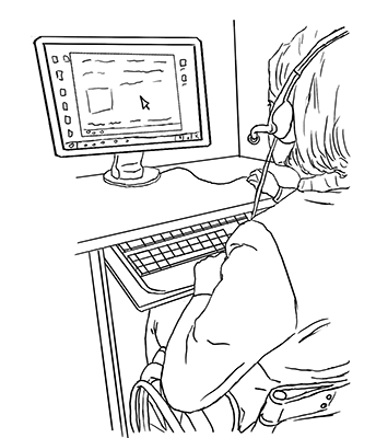A student uses the computer while wearing a headset.