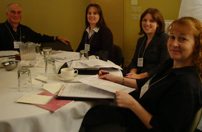 Group photo of Mel Kalkowski, Laura Winckler-Moore, Val Sundby, and Lyla Crawford at a round table