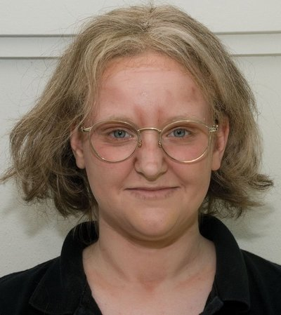 Uttecht as she looks with age makeup, glasses and gray hair.