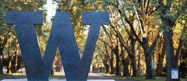 UW sign in front of campus