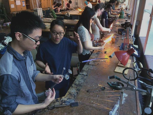 Students working with glass