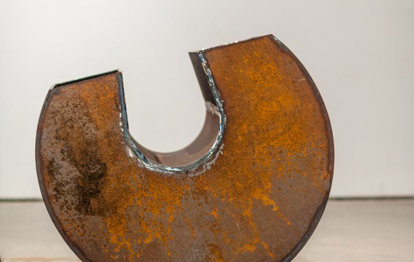 Horseshoe-shaped rusty sculpture