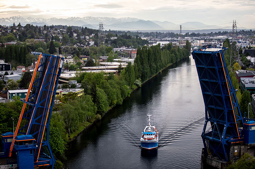 The R/V Carson passes under the Fremont Bridge on its way back to the UW.